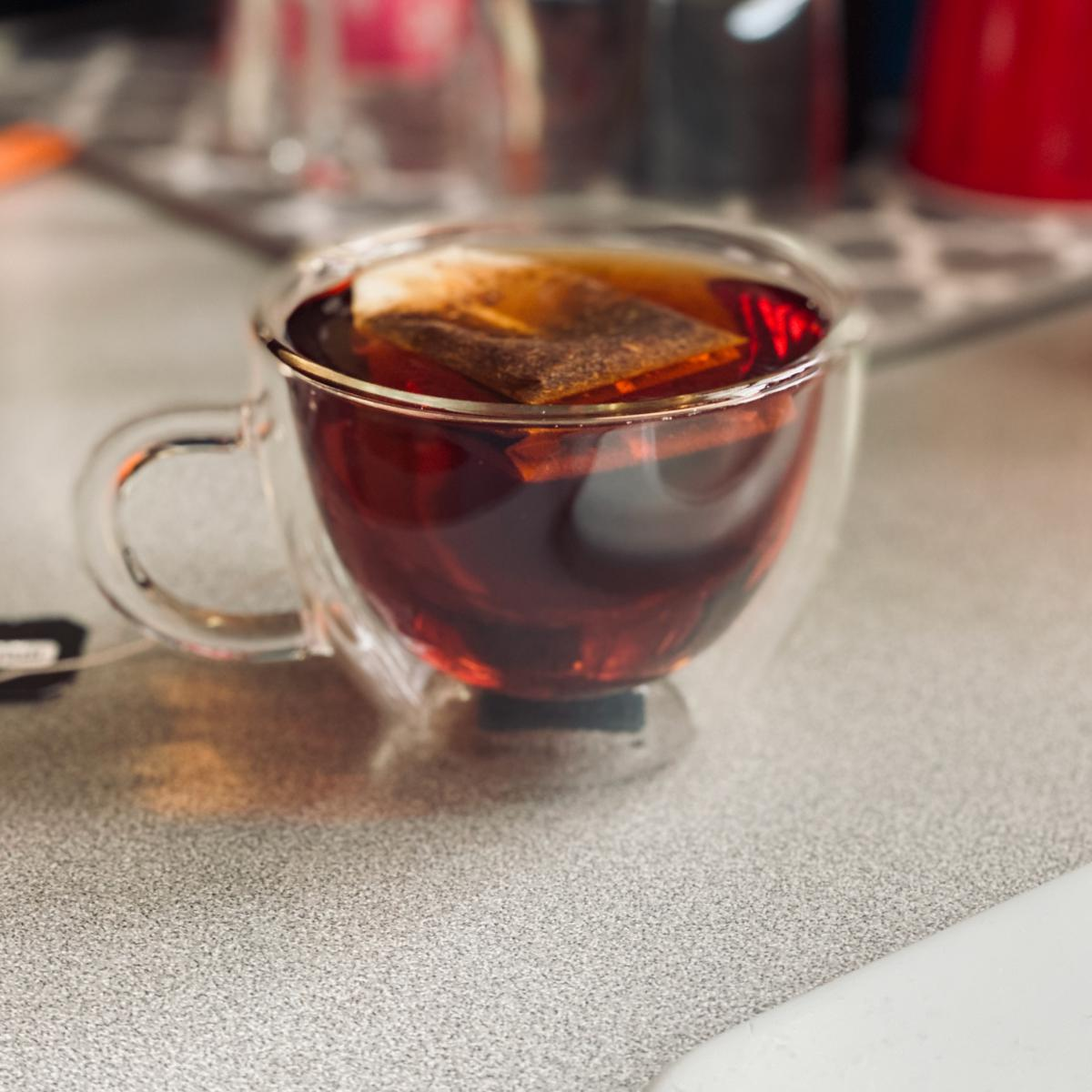 Rooibos tea steeping in a clear cup