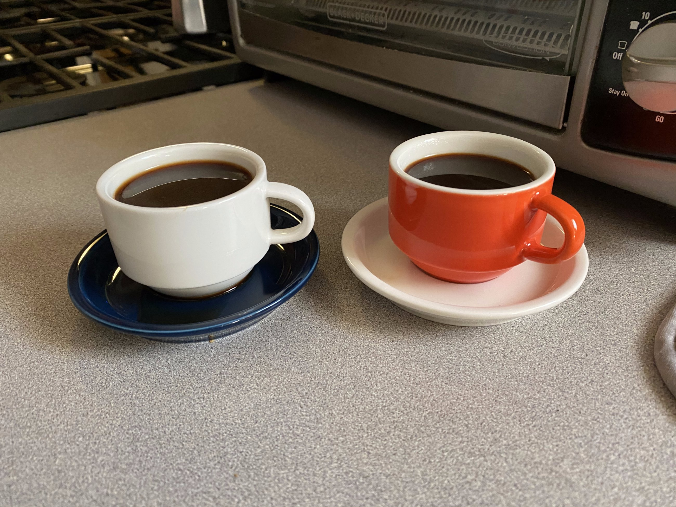 Small espresso cups on saucers